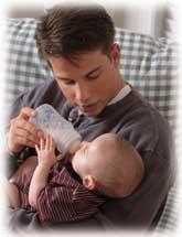 father nurturing baby